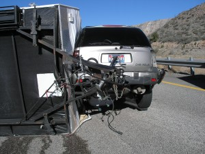 A camp trailer lays on its left side following its crash on I-15, near Toquerville, Utah, Feb. 17, 2015 | Photo courtesy of Utah Highway Patrol, St. George News