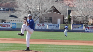 A baseball player winds up for the pitch at a tournament game at Dixie High School's Flyers Field, St. George, Utah, Feb. 16, 2015   Photo by Devan Chavez, St. George News