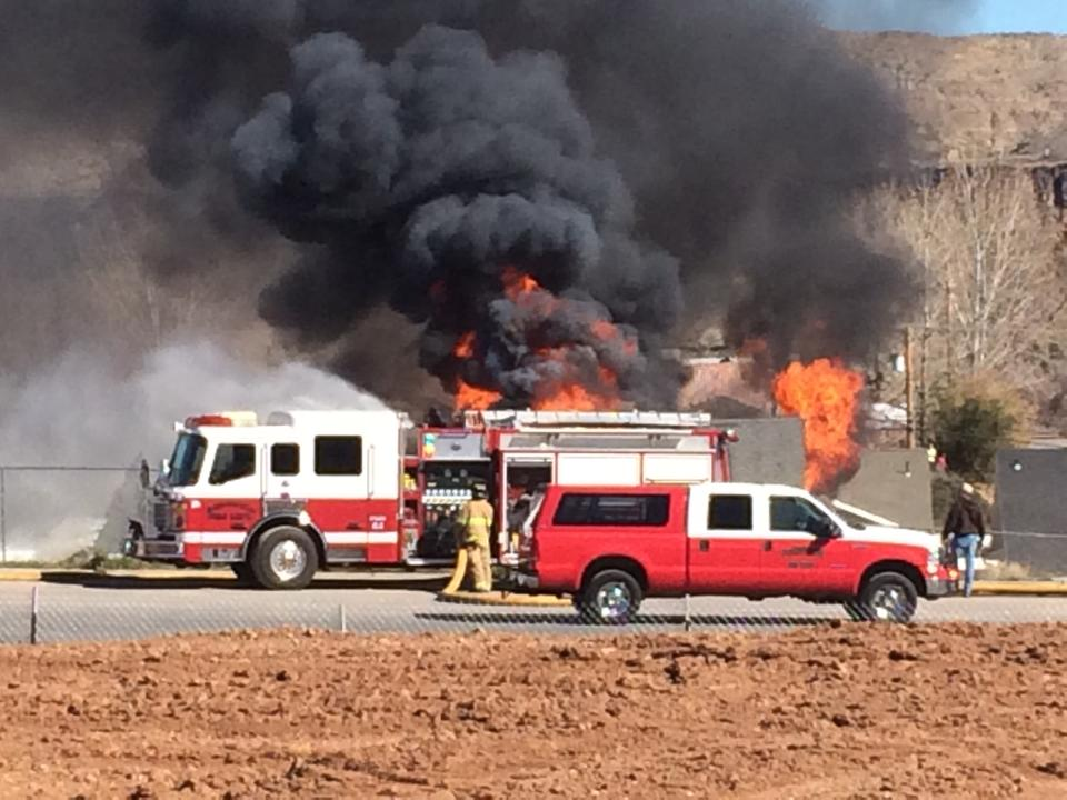 Fire crews battle a house fire in Hurricane, Utah, Feb. 25, 2015 | Photo courtesy of Travis Millett, St. George News