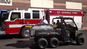St. George Mayor Jon Pike taking a ride on the fire department's new ATV, St. George, Utah, Feb. 17, 2015 | Photo by Mori Kessler, St. George