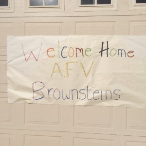 The family returns home from the taping of America's Funniest Home Videos to a banner decorated by neighbors, Santa Clara, Utah, Jan., 2015 | Photo courtesy of Rebecca Brownstein, St. George News