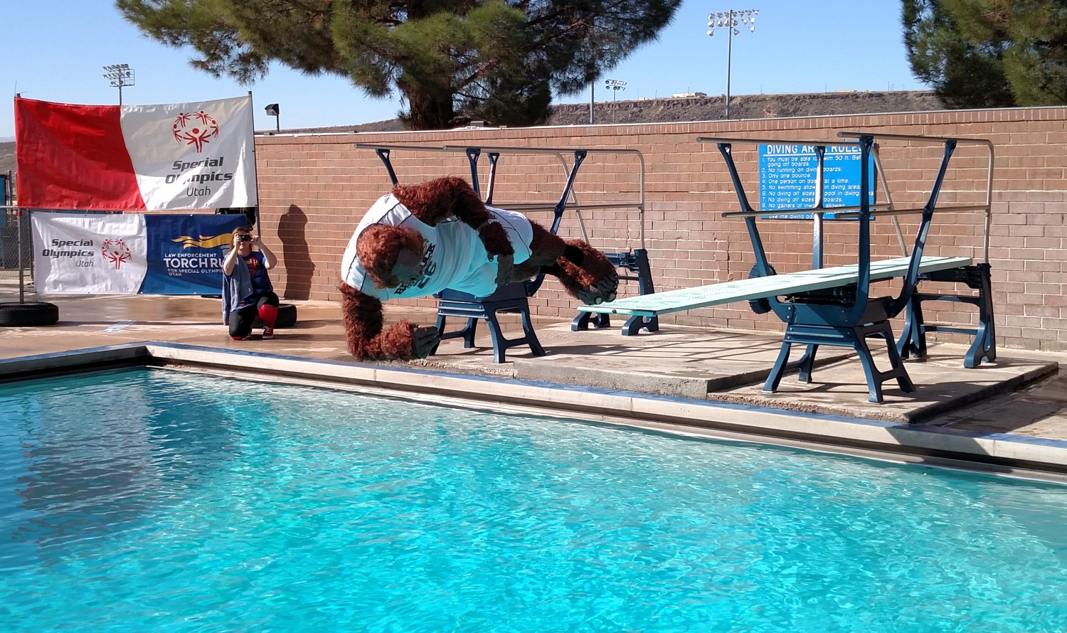 After inspecting his surroundings, Bigfoot barrel-rolled off of the diving board, St. George, Utah, Feb. 21, 2015 | Photo by Mori Kessler, St. George News