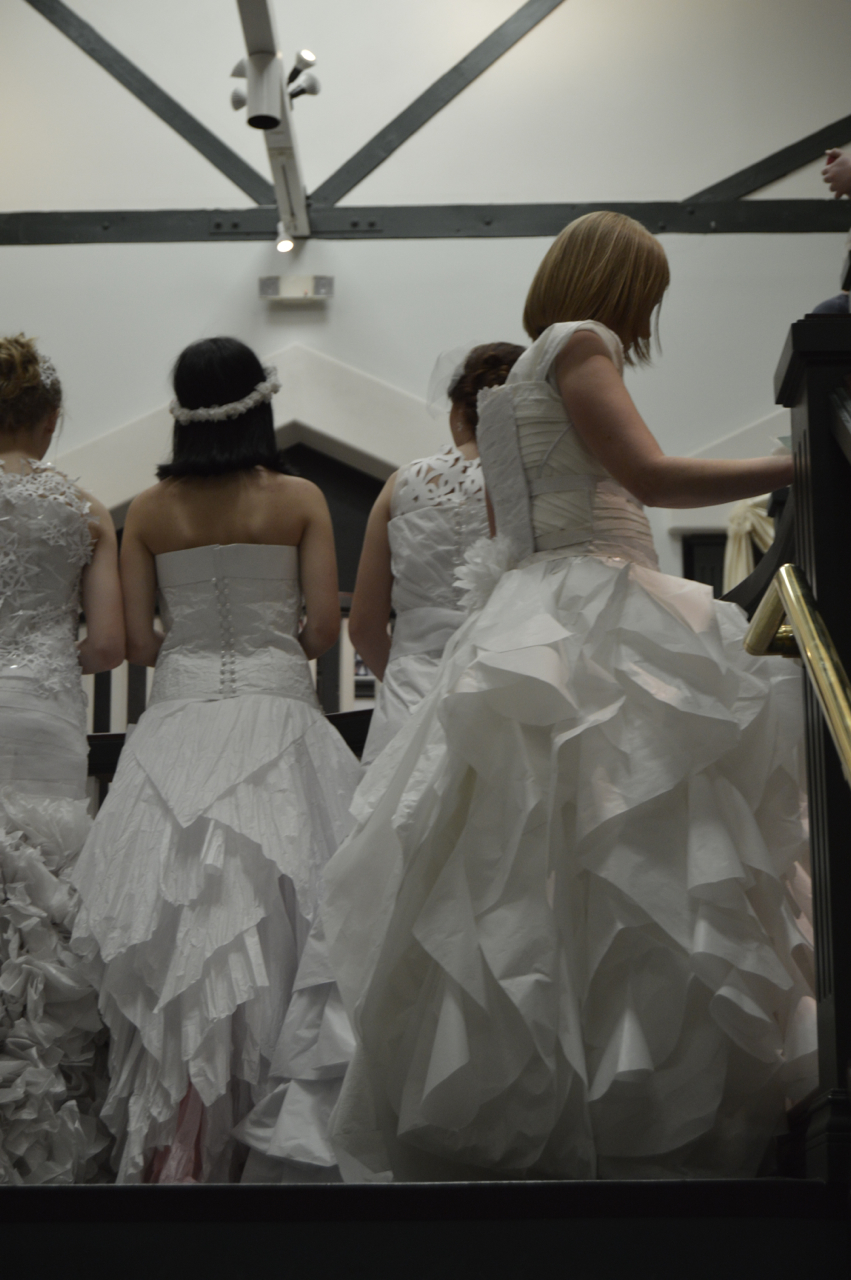 Showcasing the details of the backs of the dresses, Paper Wedding Dress Competition,