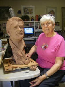 L'Deane Trueblood, renowned local artist poses with her sculpture, St. George, Utah, undated | Photo courtesy of Dixie State University, St. George News