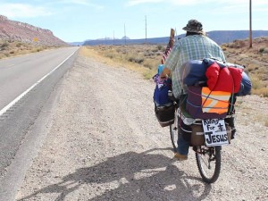 Gary Madison Mark travels across state Route 59 on his cross-country journey, Washington County, Utah, Feb. 6, 2015 | Photo by Leanna Bergeron, St. George News