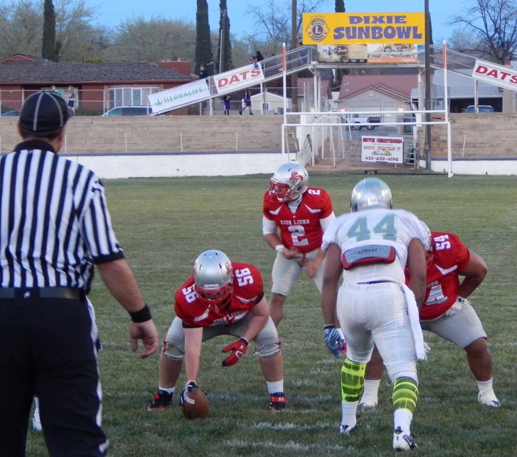 Misi Tupe calls for the snap from Trevor Stott in the first Zion Lions game at the Dixie Sun Bowl, St. George, Utah, mar. 21, 2015 | Photo by Andy Griffin, St. George News