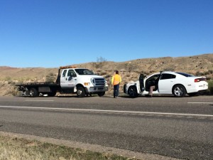 Emergency wokers guide in a tow truck to remove the Hyundai involved in an accident on Interstate-15, Washington County, Utah, March 10, 2015 | Photo by Devan Chavez, St. George News