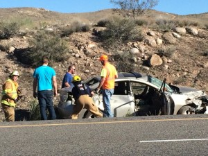 Emergency workers assess the damage of a Hyundai involved in an accident with a semi truck on Interstate-15, Washington County, Utah, March 10, 2015 | Photo by Devan Chavez, St. George News