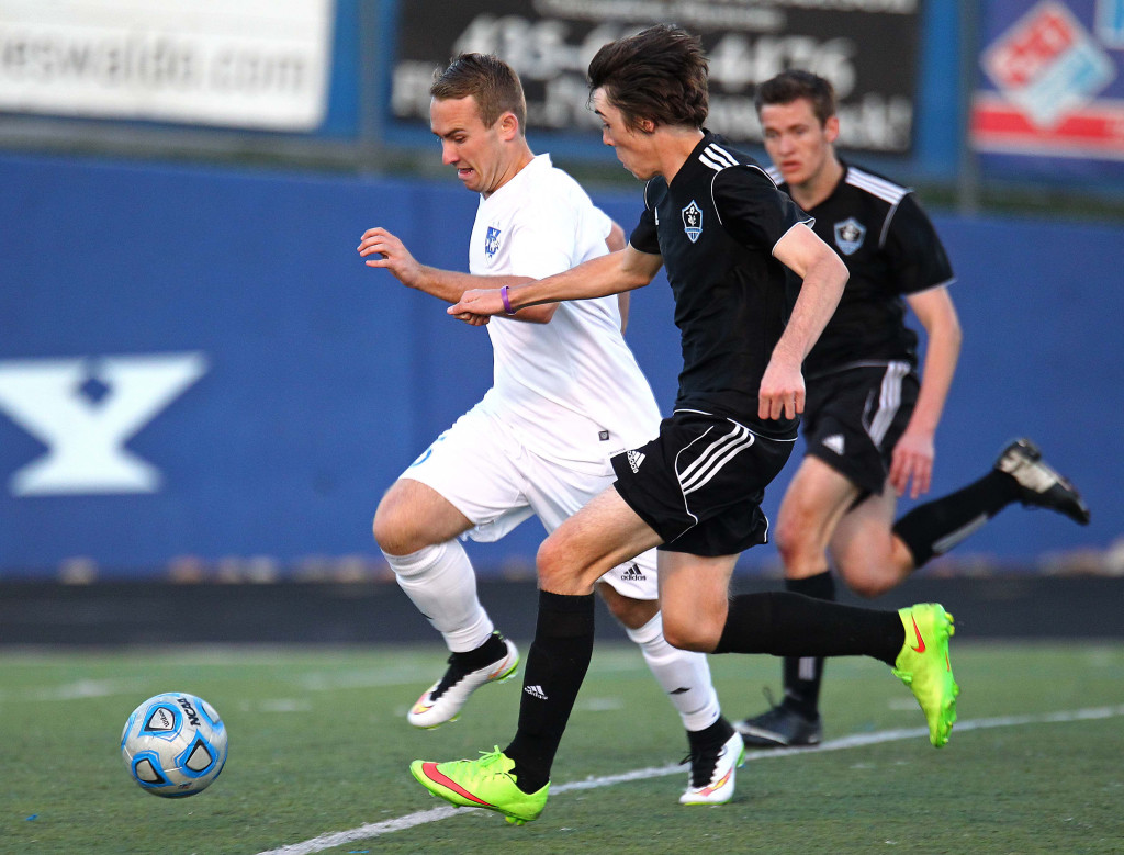 Dixie's Colton Atkin (white jersey) heads for the goal, Canyon View vs. Dixie, Boys Soccer, St. George, Utah, Mar. 12, 2015   Photo by Robert Hoppie, ASPpix.com, St. George News