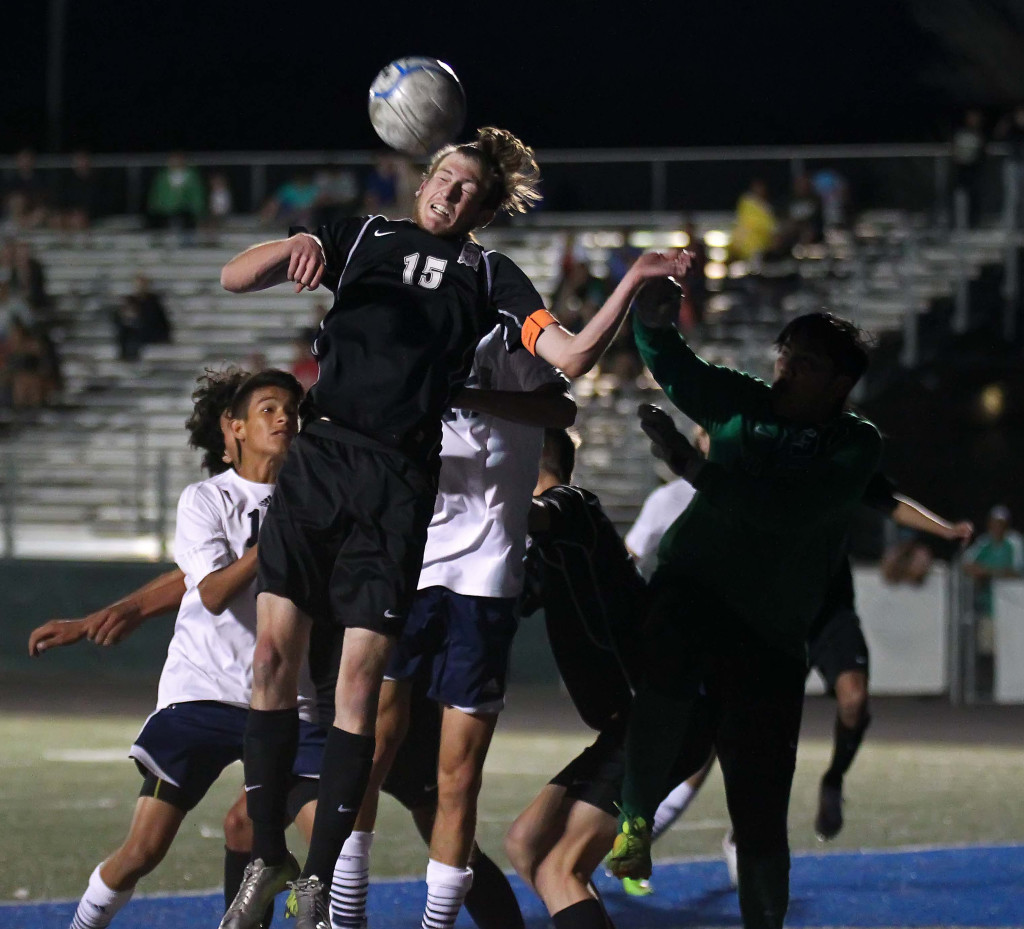 Pine View's Ethan Baer (15) heads the ball out of danger, Pine View vs. Snow Canyon, boys soccer, St. George, Utah, Mar. 17, 2015 | Photo by Robert Hoppie, ASPpix.com, St. George News