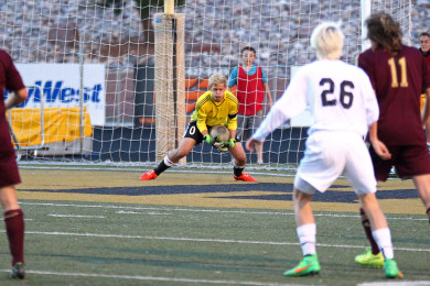 Cedar goalkeeper makes a save on a shot by Desert Hills' Kanon Heaton (26), Cedar vs. Desert Hills, Soccer, St. George, Utah, Mar. 24, 2015 | Photo by Robert Hoppie, ASPpix.com, St. George News