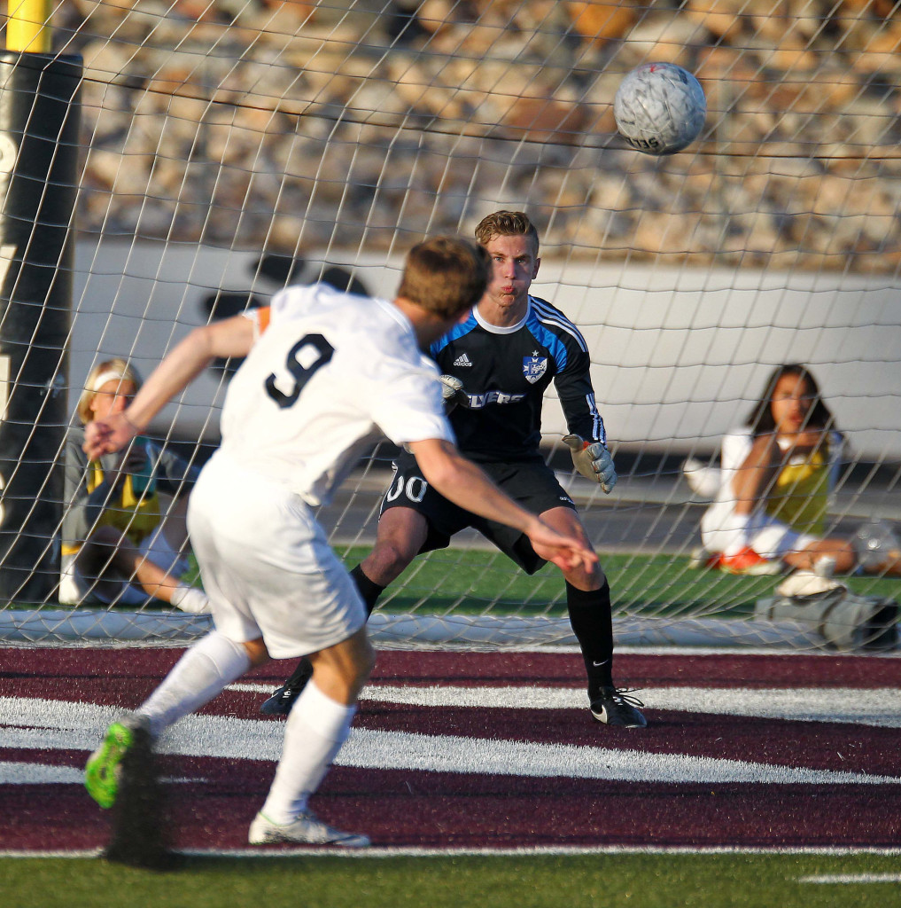 Pine View's Michael Wade (9) fires a shot at Dixie goalkeeper Ethan Poulton. Poulton was injured and taken to the hospital with a concussion later in the game. Dixie vs. Pine View, Soccer, St. George, Utah, Mar. 26, 2015   Photo by Robert Hoppie, ASPpix.com, St. George News