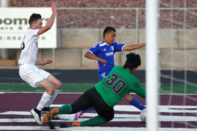 """Pine View goalkeeper Javier Gaona (30) stops a shot by Dixie's Jose """"Tauri"""" Morales, Dixie vs. Pine View, Soccer, St. George, Utah, Mar. 26, 2015 
