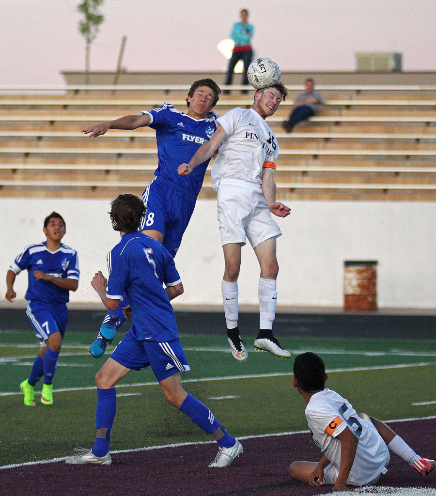 Ethan Baer heads a ball for Pine View as Tyler Bennett defends for Dixie, Dixie vs. Pine View, Soccer, St. George, Utah, Mar. 26, 2015   Photo by Robert Hoppie, ASPpix.com, St. George News
