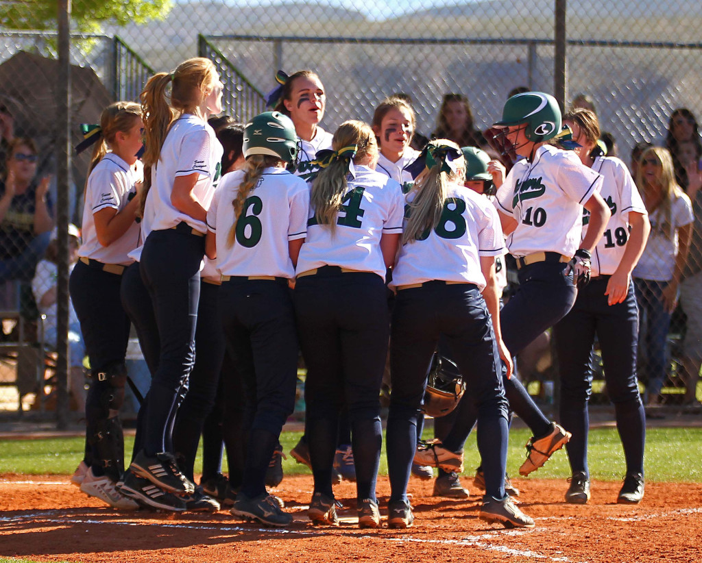 Snow Canyon's Katelyn Flowers (10) is greeted by her teammates at home after she launched a home run, Dixie vs. Snow Canyon, Softball, St. George, Utah, Mar. 27, 2015 | Photo by Robert Hoppie, ASPpix.com, St. George News