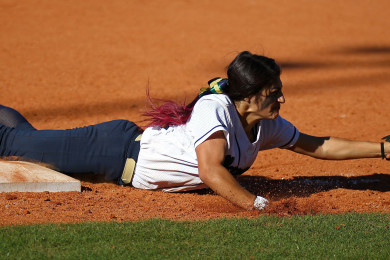 Snow Canyon shortstop Sonya Hardy dives for a ball but loses control, Dixie vs. Snow Canyon, Softball, St. George, Utah, Mar. 27, 2015 | Photo by Robert Hoppie, ASPpix.com, St. George News