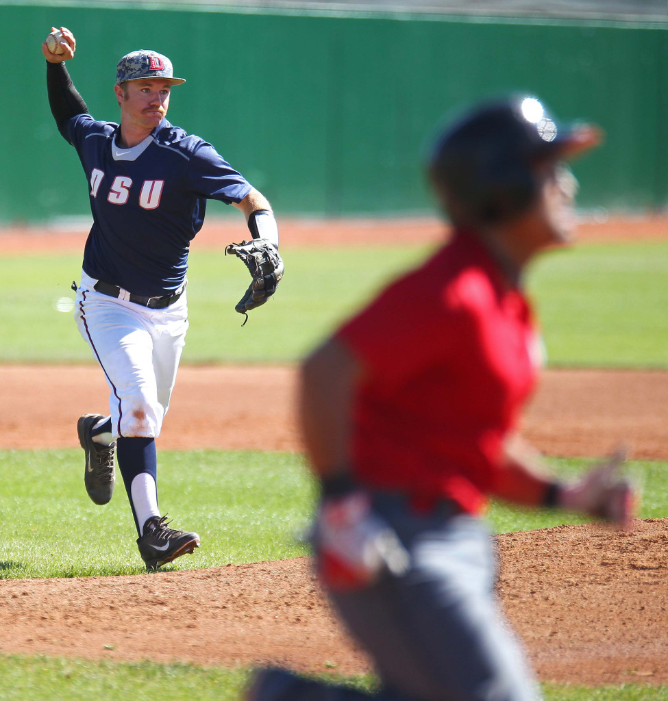 Red Storm third baseman Austin Nelson fires the ball to first base for an out, Dixie State University vs. Academy of Art University, Baseball, St. George, Utah, Mar. 28, 2015 | Photo by Robert Hoppie, ASPpix.com, St. George News
