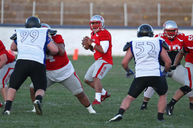 Lions quarterback Misi Tupe looks for an open receiver, Zion Lions vs. Utah Cobras, Football, St. George, Utah, Mar. 28, 2015 | Photo by Robert Hoppie, ASPpix.com, St. George News