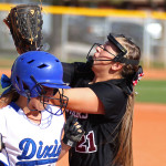 Pine View first baseman Jodan Gosik (21) tries to catch a pop up as Dixie's Shaunna Gelter runs to first base, Pine View vs. Dixie, Softball, St. George, Utah, Mar. 31, 2015 | Photo by Robert Hoppie, ASPpix.com, St. George News