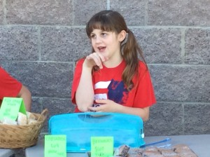 Summer Eardley waits for customers to buy her baked goods at her class bake sale, March 6, 2015 | Photo by Holly Coombs, St. George News