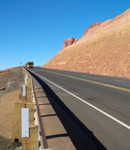 The first vehicle to use the newly rebuilt U.S. 89 highway south of Page after it was reopened to traffic for the first time Friday following the Feb. 20, 2013, landslide, Page, Arizona, March 27, 2015 | Photo courtesy of the Arizona Department of Transportation, St. George News