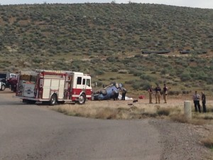 Emergency responders investigate a rollover on Landfill Road, Washington City, Utah, March 22, 2015 | Photo by Holly Coombs, St. George News