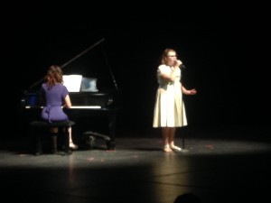 """Ellie Stark sings """"God Helps The Outcast,"""" while her aunt, Hollie Reina accompanies her on piano at a celebratory concert, St. George, Utah, March 26, 2015 
