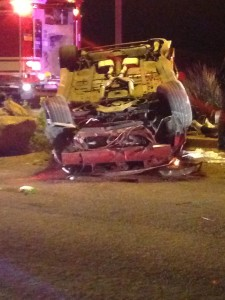 A Ford Mustang lands on its top after an accident on Snow Canyon Parkway, Ivins, Utah, March 26, 2015 | Photo by Holly Coombs, St. George News