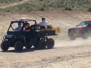 Emergency responders transport  a 17-year-old boy in the Fire Department's six-wheel Polaris Ranger on Bearclaw Poppy Trail, St. George, Utah, March 28, 2015 | Photo by Holly Coombs, St. George News