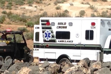 Emergency responders aid a 17-year-old who wrecked on a mountain bike while riding Bear Claw Poppy Trail, St. George, Utah, March 28, 2015 | Photo by Holly Coombs, St. George News