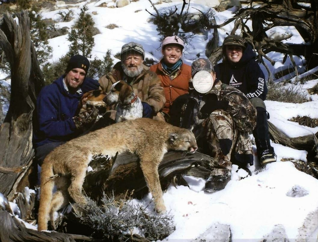 L-R: Nicholaus Rodgers, Christopher Loncarich, Andie Loncarich, unidentified hunter and Caitlin Loncarich with a mountain lion killed in Utah without a license, then illegally checked in Colorado. Exact location not specified, Nov. 20, 2014 | Photo courtesy of Colorado Parks and Wildlife, St. George News