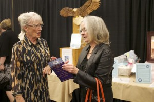 Hope founder Merry Jo Cook (left) visits with a guest at the banquet, St. George, Utah, Feb. 28, 2015 | Photo by, Rhonda Tommer, St. George News.