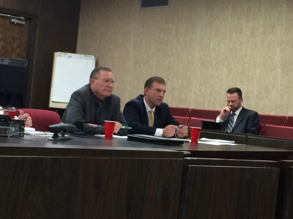 Iron County Commissioners Dale Brinkerhoff (left) and David Miller (center) prepare to announce their decision on the Ambulance Service as Deputy County Attorney Mike Edwards (right) checks his computer, Parowan, Utah, March 9, 2015 | Photo by Devan Chavez, St. George News