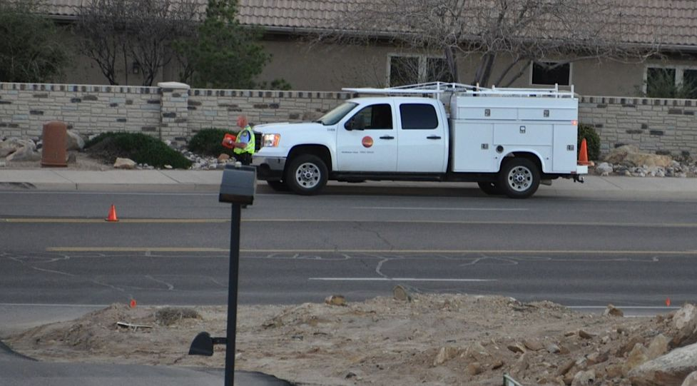 A City of St. George utility worker surveys the damage done by an early morning car accident at 1450 South and S. 2580 East, St. George, Utah, Mar. 21, 2015  | Photo by Shane Brinkerhoff, St. George News