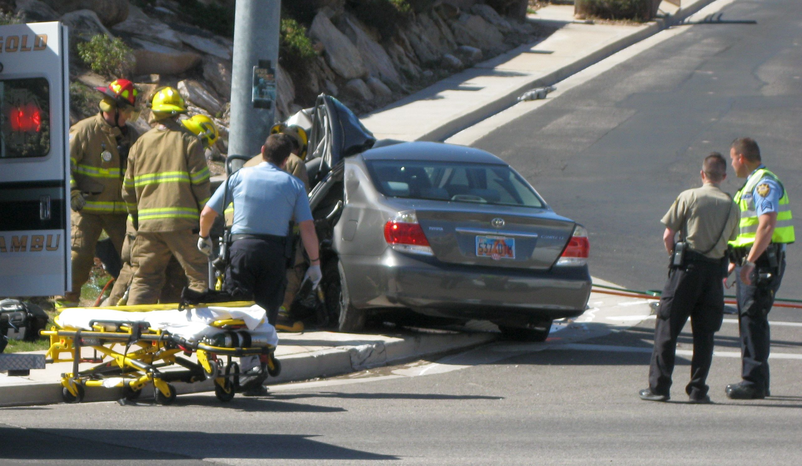 A woman died from the injuries she sustained during a collision with a light pole at the Valley View Drive and Dixie Drive intersection, St. George, Utah, March 8, 2014 | Photo by Ric Wayman, St. George News