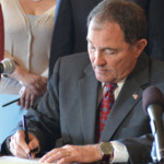 Gov. Gary Herbert signing a bill passed by the Legislature, Salt Lake City, April 2015 | Photo courtesy of the Utah Governor's Office, St. George News