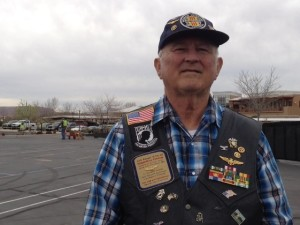 """Vietnam veteran Ron Lewis pauses at """"The Wall That Heals"""" to tell a personal story, Washington City, Utah, March 11, 2015 