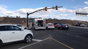 A collision between a motorcycle and a white SUV shut down traffic on the I-15 overpass on St. George Boulevard, St. George, Utah, March 12, 2015 | Photo by Holly Coombs, St. George News