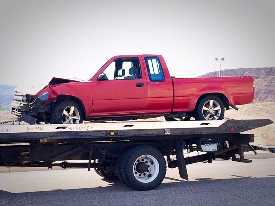 A Toyota truck was rendered inoperable after crashing into the back of a car on Brigham Road and had to be towed from the scene, St. George, Utah, March 31, 2015 | Photo by Kimberly Scott, St. George News