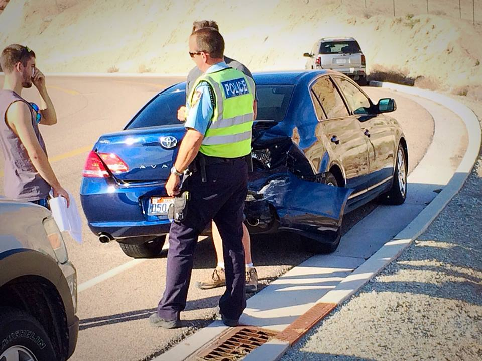 A blue Toyota Avalon received significant rear-end damage during a collision on Brigham Road, St. George, Utah, March 31, 2015 | Photo by Kimberly Scott, St. George News