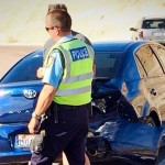 A blue Toyota Avalon received significant rear-end damage during a collision on Brigham Road, St. George, Utah, March 31, 2015   Photo by Kimberly Scott, St. George News