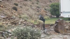 Washington County Bomb Squad member inspecting a blasting hole where abandoned, undetonated explosives await removal, Hurricane, Utah, March 2, 2015 | Photo by Mori Kessler, St. George News