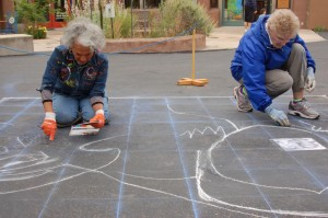 Potters and now street painters, Liz Shore (L), and Gloria Reynolds (R ), of Zia Pottery, get started on their chalk mural at the Kayenta Street Painting Festival, Ivins, Utah, April 26, 2014 | Photo by Hollie Reina, St. George News