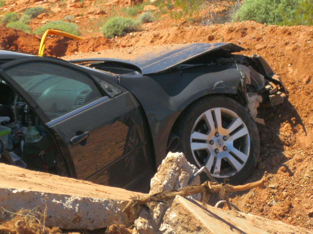 A woman was arrested Monday for DUI after crashing her car into a concrete berm on 1000 East, St. George, Utah, April 13, 2015   Photo by Ric Wayman, St. George News
