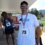 Eric Lewis displaying his trophy after winning the quarter marathon, Cedar City, Utah, May 17, 2014 | Photo courtesy of Iron County Children's Justice Center