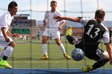 Dixie's Francisco Guzman and McLane Keenan battle in front of the Union goalkeeper, Dixie vs. Union, Soccer, St. George, Utah, Apr. 30, 2015 | Photo by Robert Hoppie, ASPpix.com, St. George News