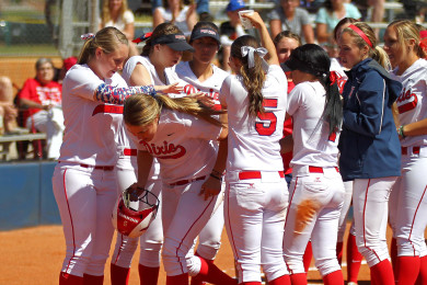 The Red Storm congratulate Courtney Sherwin after her third inning home run, Dixie State University vs. Notre Dame de Namur University, Softball, St. George, Utah, Apr. 11, 2015 | Photo by Robert Hoppie, ASPpix.com, St. George News