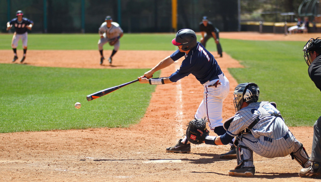 File photo as Tanner Morache (7) takes a swing for Dixie State, vs. California Baptist, St. George, Utah, Apr. 11, 2015 | Photo by Robert Hoppie, ASPpix.com, St. George News