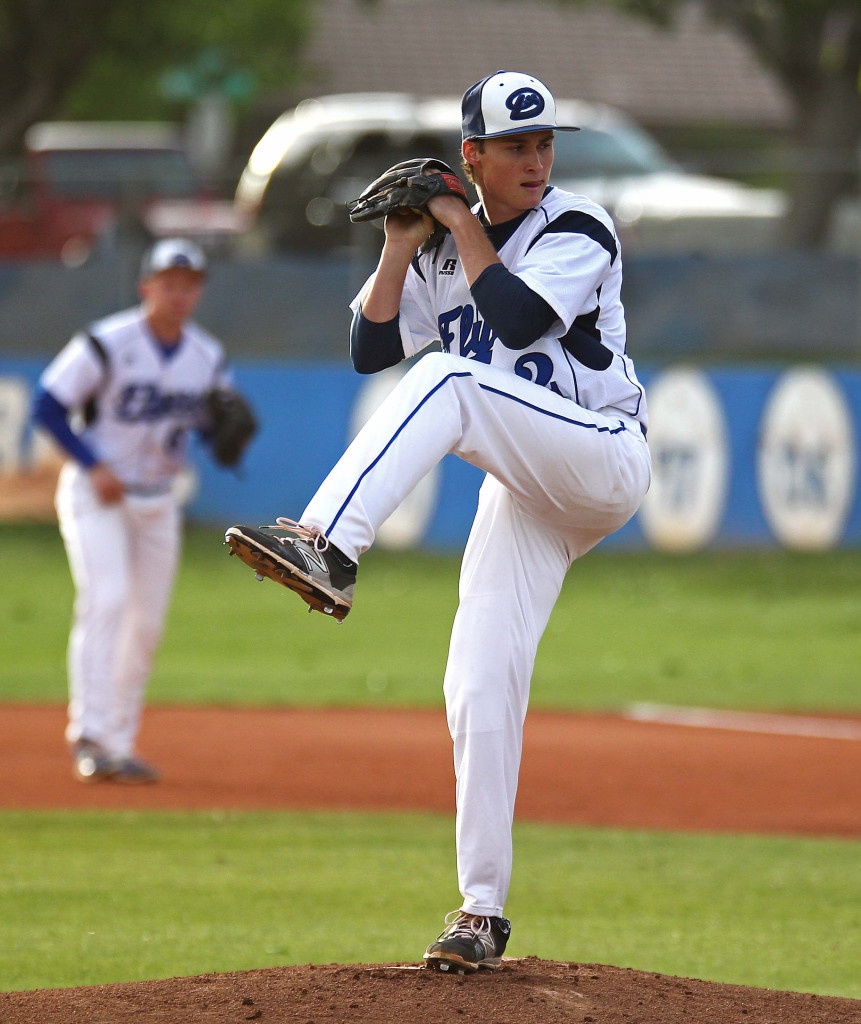 Dixie High's Drew Bailey pitches the ball. with cars from 700 South in the background, file photo from Pine View vs. Dixie, Baseball, St. George, Utah, Apr. 14, 2015 | Photo by Robert Hoppie, ASPpix.com, St. George News
