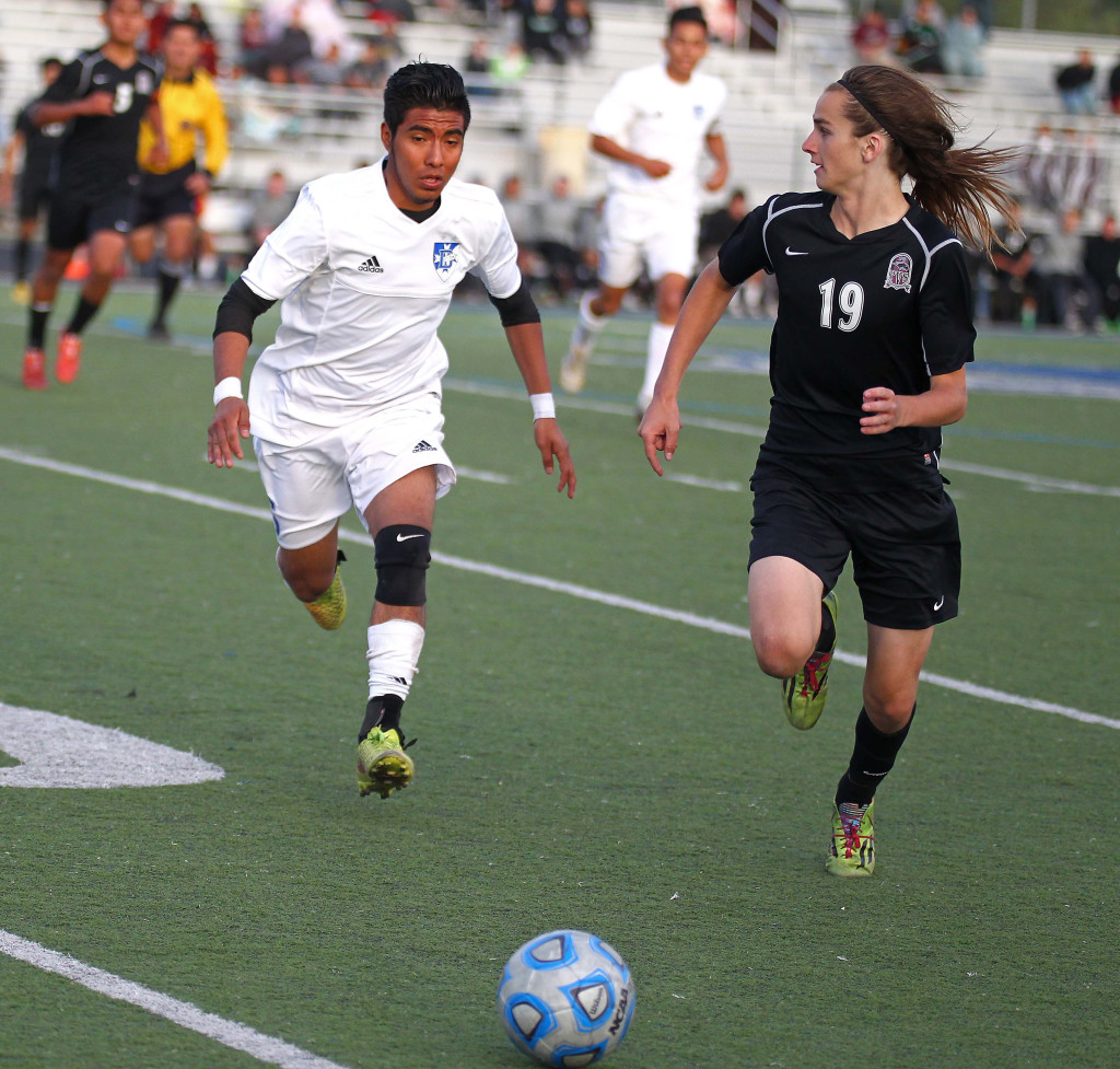 Dixie's Luis Bernabe and Pine View's Kalob Dudley (19) chase down a loose ball, Pine View vs. Dixie, Soccer, St. George, Utah, Apr. 14, 2015 | Photo by Robert Hoppie, ASPpix.com, St. George News